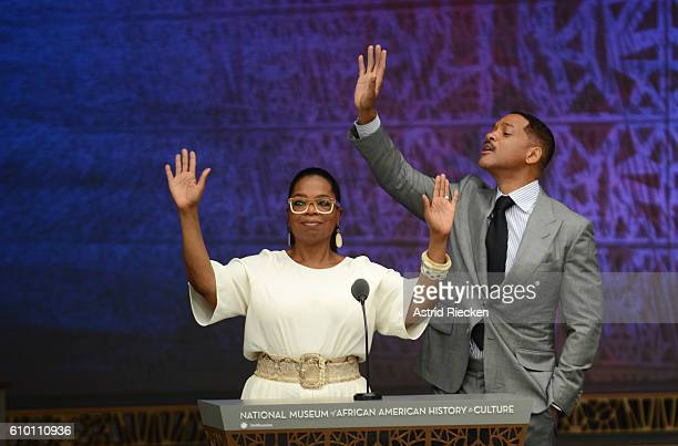 TV celebrity Oprah and actor Will Smith greet the crowd before quoting poems of famous African American poets during the dedication of the National...
