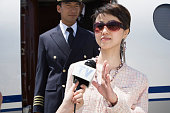Celebrity Passenger and Pilot Alighting From Private Jet