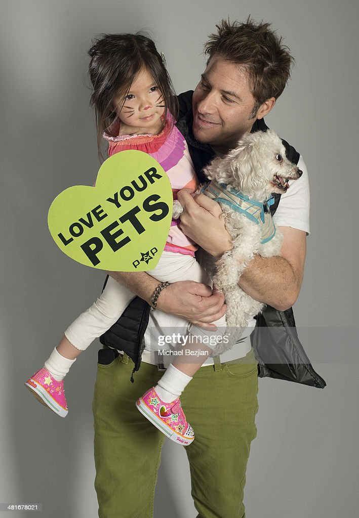 Celebrity photographer Ken Sax and daughter pose for Portraits For Pooches on March 30, 2014 in Beverly Hills, California.