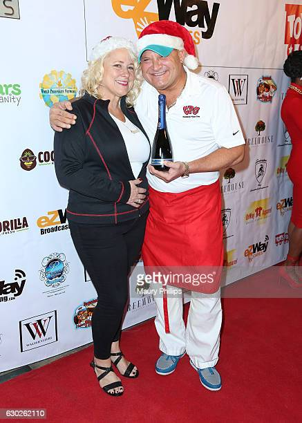 Celebrity Pizza Guy Nick Rubin and Penny Latham arrive at eZWayCares Community Santa Toy Drive on December 18 2016 in Los Angeles California