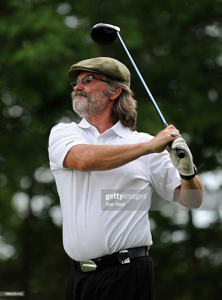 Celebrity player <a gi-track='captionPersonalityLinkClicked' href=/galleries/search?phrase=Kurt+Russell&family=editorial&specificpeople=206294 ng-click='$event.stopPropagation()'>Kurt Russell</a> hits a drive on the 15th hole during the third round of the BMW Charity Pro-Am Presented by SYNNEX Corporation at the Thornblade Club on May 18, 2013 in Greer, South Carolina.