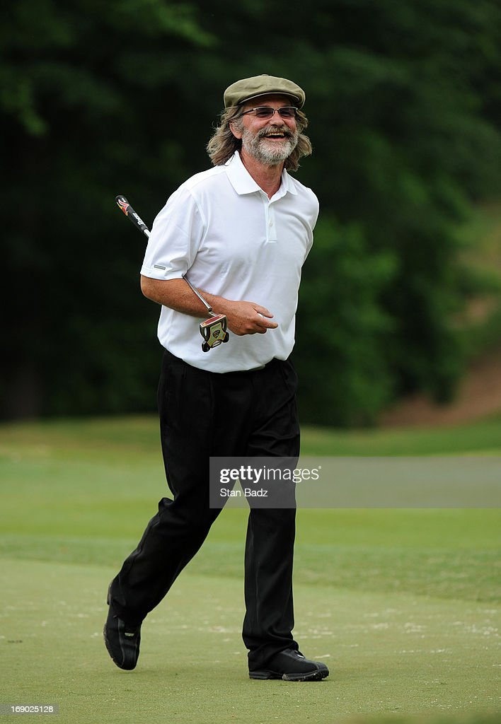 Celebrity player <a gi-track='captionPersonalityLinkClicked' href=/galleries/search?phrase=Kurt+Russell&family=editorial&specificpeople=206294 ng-click='$event.stopPropagation()'>Kurt Russell</a> smiles as he exits the 18th green during the third round of the BMW Charity Pro-Am Presented by SYNNEX Corporation at the Thornblade Club on May 18, 2013 in Greer, South Carolina.