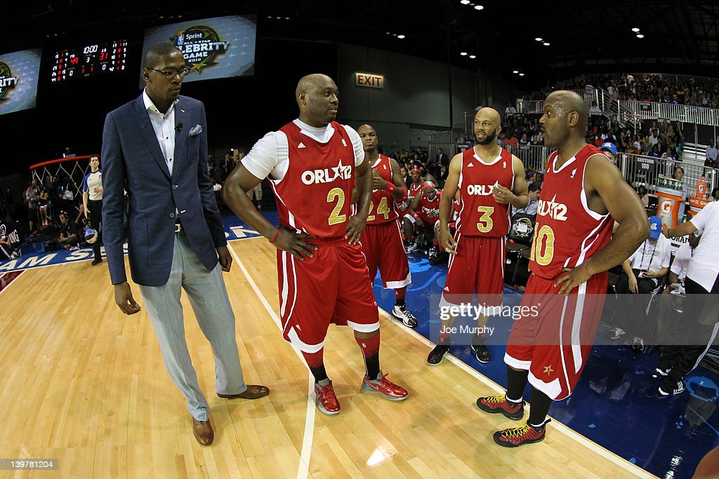 Celebrity players of the West team talk during the Sprint All-Star Celebrity Game on center court at Jam Session during the NBA All-Star Weekend on February 24, 2012 at the Orange County Convention Center in Orlando, Florida.