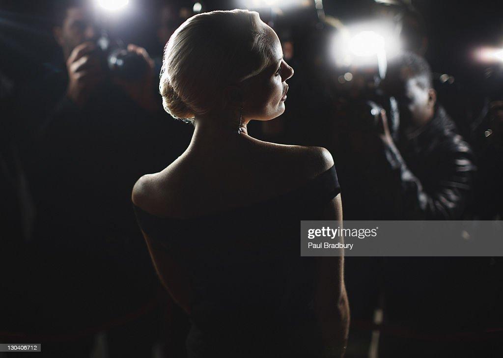 Celebrity posing for paparazzi