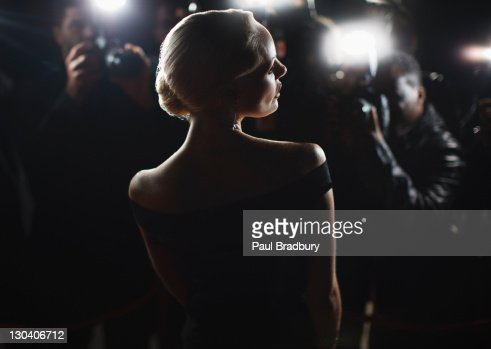 Celebrity posing for paparazzi : Stock Photo