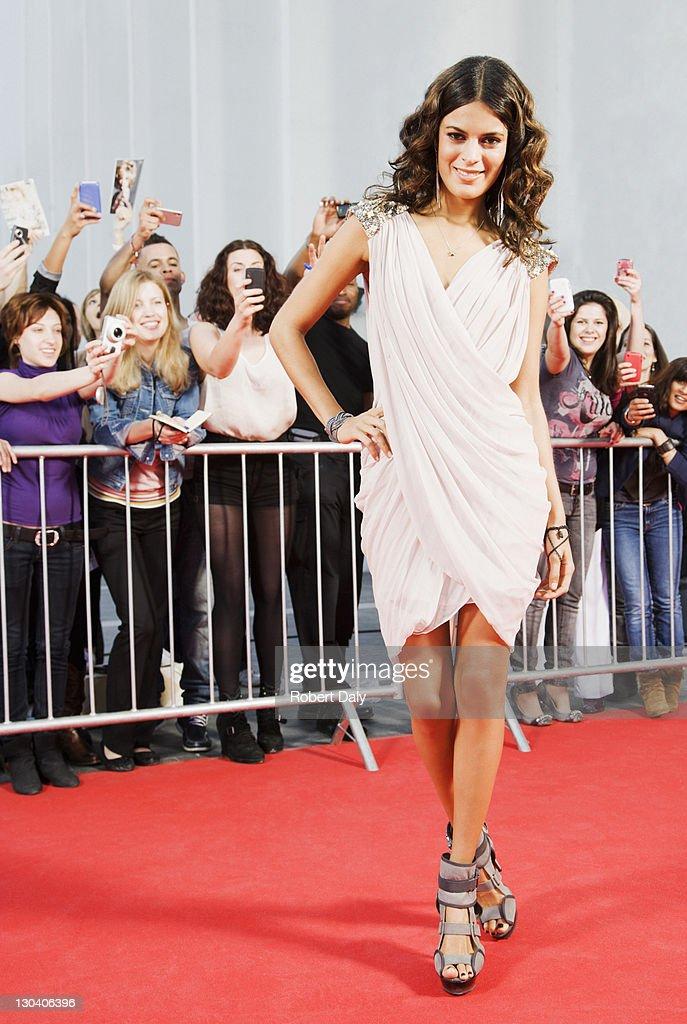 Celebrity posing on red carpet : Stock Photo