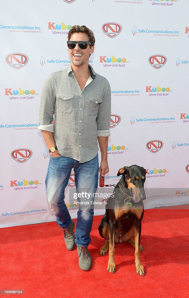 Celebrity realtor and television personality Madison Hildebrand and his dig Maya arrive at 'Family Day' hosted by Nick Cannon at Santa Monica Pier on October 6, 2012 in Santa Monica, California.