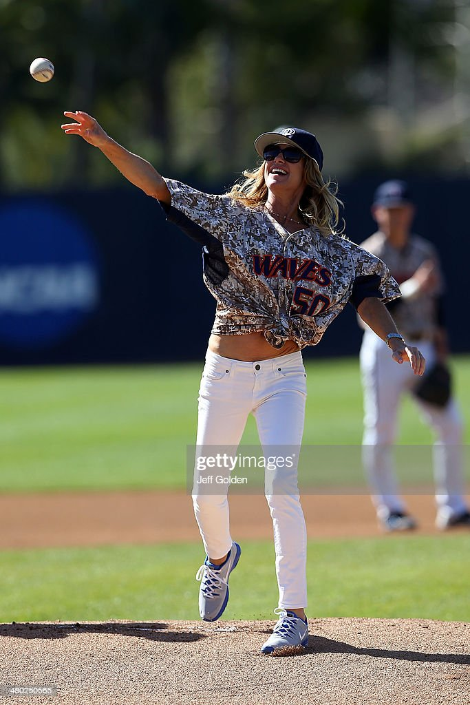 Celebrity restaurateur Liza Utter throws out the ceremonial first pitch before the NCAA men's college baseball game between the Houston Cougars and the Pepperdine Waves at Eddy D. Field Stadium on March 9, 2014 in Malibu, California. Pepperdine won 3-0.