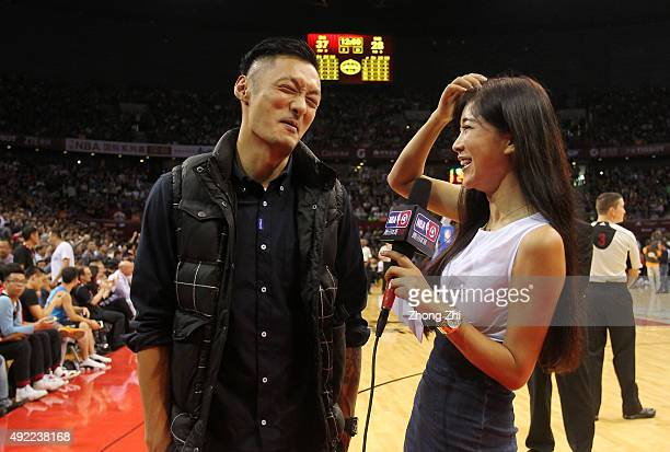 Celebrity Shawn Yue is interviewed by Betty Zhou during a timeout of the match between Charlotte Hornets and Los Angeles Clippers as part of the 2015...