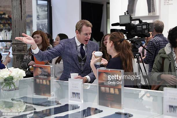 Celebrity Style Expert Carson Kressley speaks to an editor during the 'SculpSure Day With the Denim Doctor' event with Dr Dennis Gross at 3x1 on...