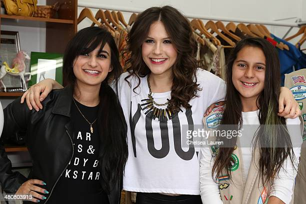 Celebrity stylist Jazmin Whitley and actress Erin Sanders recieve a year's worth of Girl Scout Cookies from a local troop on March 26 2014 in Los...
