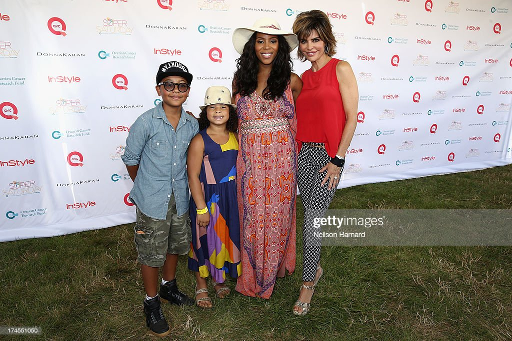 Celebrity Stylist <a gi-track='captionPersonalityLinkClicked' href=/galleries/search?phrase=June+Ambrose&family=editorial&specificpeople=619410 ng-click='$event.stopPropagation()'>June Ambrose</a> (2nd from R) and QVC Red Carpet Host <a gi-track='captionPersonalityLinkClicked' href=/galleries/search?phrase=Lisa+Rinna&family=editorial&specificpeople=202100 ng-click='$event.stopPropagation()'>Lisa Rinna</a> attend QVC Presents Super Saturday LIVE! at Nova's Ark Project on July 27, 2013 in Water Mill, New York.