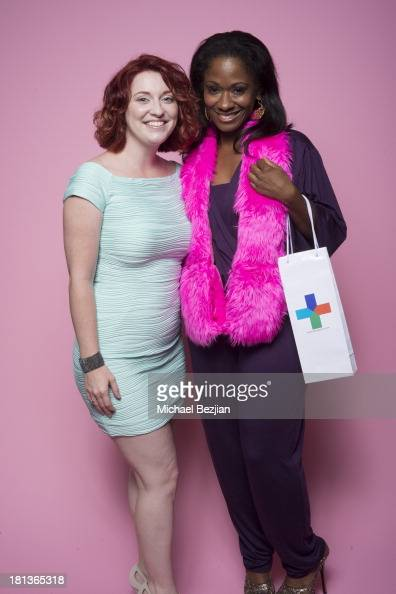 Celebrity stylist Okera Banks gets a gift from 'Skin Again' at the Mark Kearney Group 'Iced Out' Luxury Emmy Suite on September 20 2013 in Los...