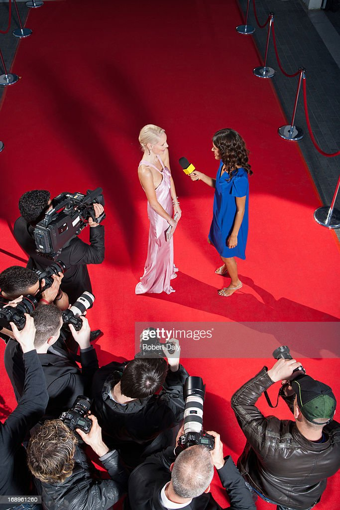Celebrity talking to reporter on red carpet : Stock Photo
