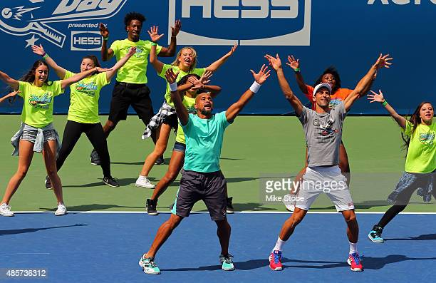 Celebrity trainer Shaun T and Novak Djokovic of Serbia take part in Arthur Ashe Kids' Day at the USTA Billie Jean King National Tennis Center on...