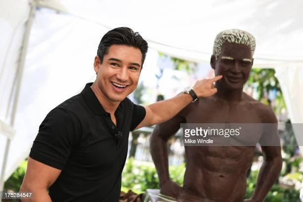 Celebrity TV host actor and heartthrob Mario Lopez unveils a chocolate statue of himself sculpted in DOVE¨ Mint Dark Chocolate Swirl to launch the...