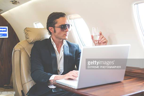 Celebrity with sunglasses in private jet airplane