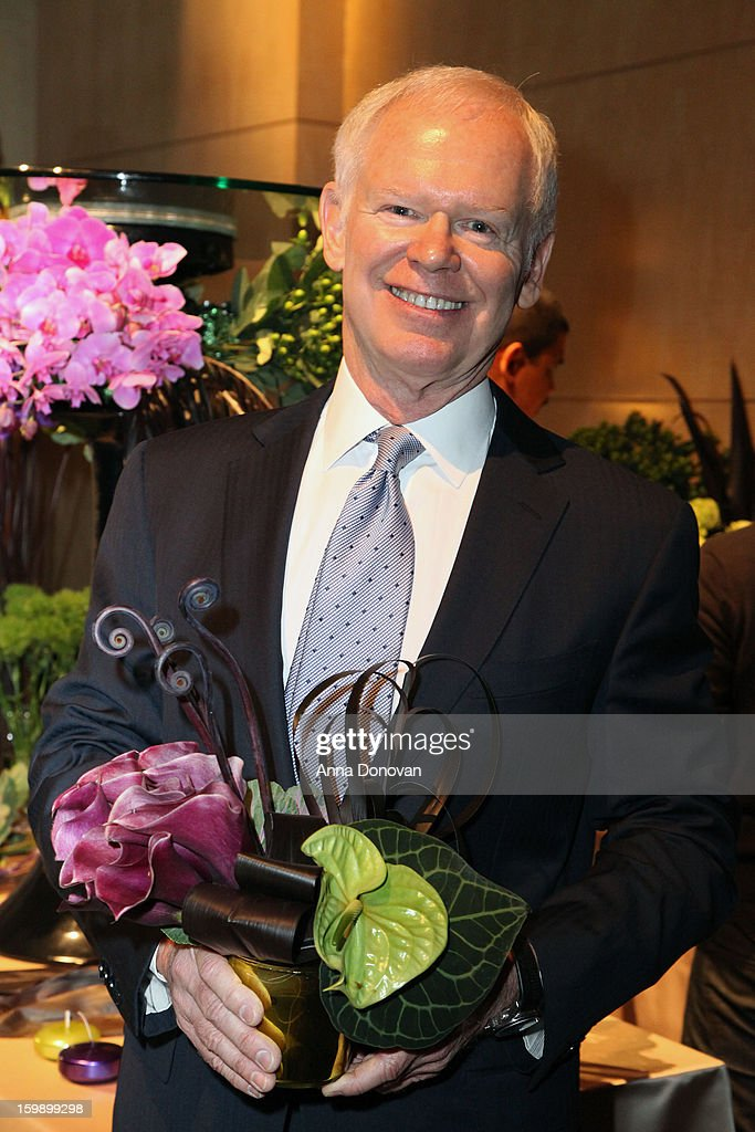 Celebrted florist Mark Held, co-owner of Mark's Garden holds a centerpiece during a preview of the 85th Academy Awards Governors Ball on January 22, 2013 in Hollywood, California.