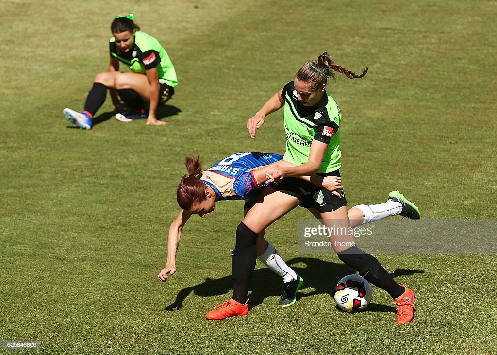 Celeste Boureille of Canberra competes with Emma Stanbury of the Jets during the round four W-League match between Canberra United and the Newcastle Jets at McKellar Park on November 26, 2016 in Canberra, Australia.
