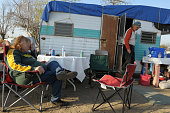 Celeste Trettin and her husband Rick Trettin outside their camper in Tent City in Ontario California The Trettin's lost their home to foreclosure and...
