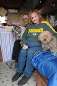 Celeste Trettin and her husband Rick Trettin sit in their camper with Miss Pepsi the Shitzu and Lance the toy poodle The Trettin's lost their home to...
