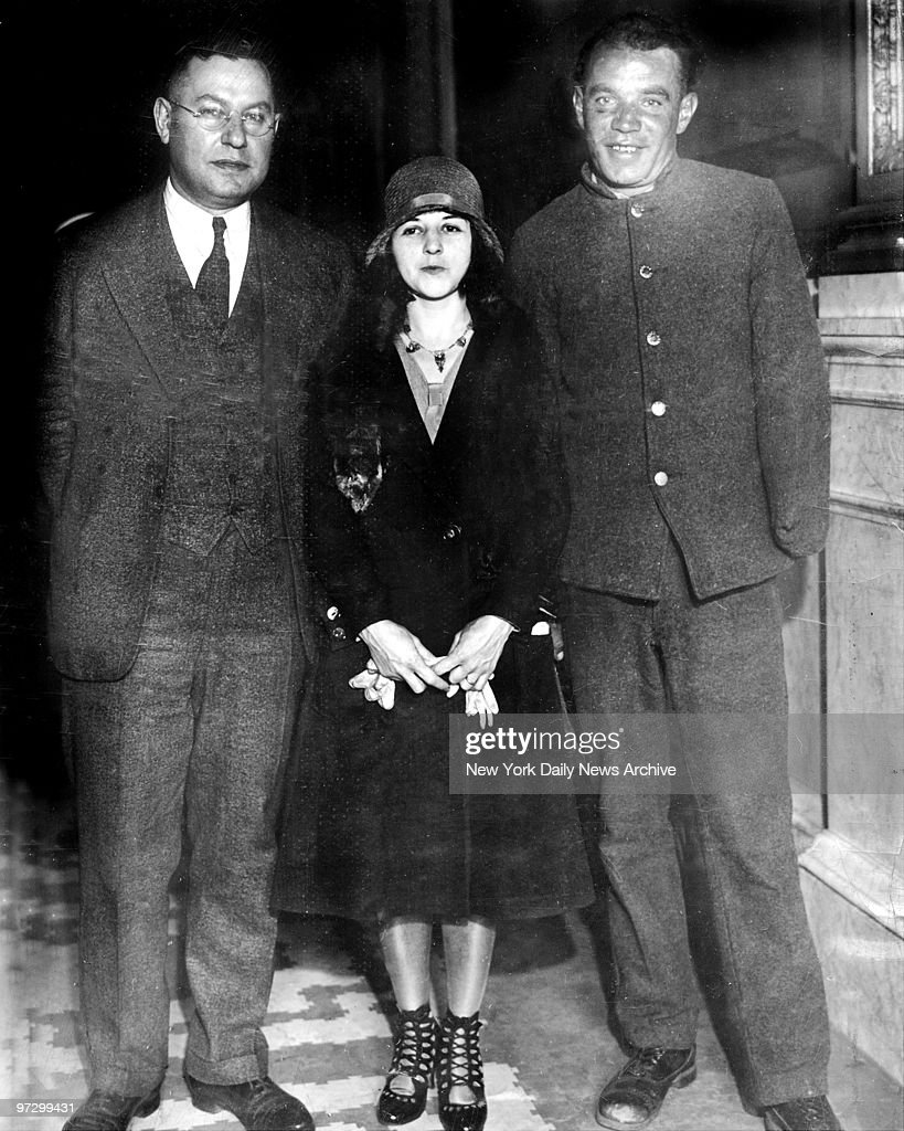 Celia Cooney Brooklyn's famous bobbedhair bandit shown with her one armed husband Edward Cooney at Auburn Prison in Syracuse New York Seeing each...