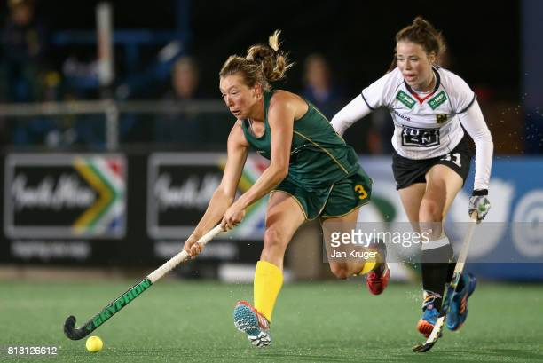 Celia Evans of South Africa attempts to get away from Amelie Wortmann of Germany during the Quarter Final match between Germany and South Africa...