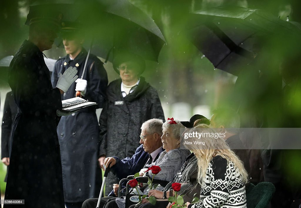 Celia Gray (R), sister of Army Corporal David J. Wishon, attends Wishon's funeral at Arlington National Cemetery May 6, 2016 in Arlington, Virginia. Corporal Wishon was assigned to a medical unit in the 7th Infantry Division when he went missing after an attack on Dec. 1, 1950 in the Korean War.