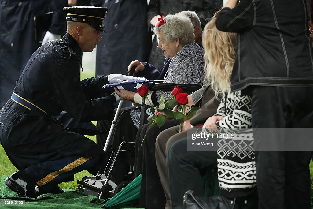 Celia Gray, sister of Army Corporal David J. Wishon, receives a flag from Army Command Sergeant Major Michael Callahan McCann during Wishon's funeral at Arlington National Cemetery May 6, 2016 in Arlington, Virginia. Corporal Wishon was assigned to a medical unit in the 7th Infantry Division when he went missing after an attack on Dec. 1, 1950 in the Korean War.
