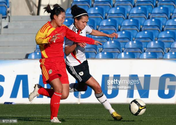 Celia Mbabi of Germany and Li Danyang of China battle for the ball during the Woman Algarve Cup match between Germany and China at the Estadio...