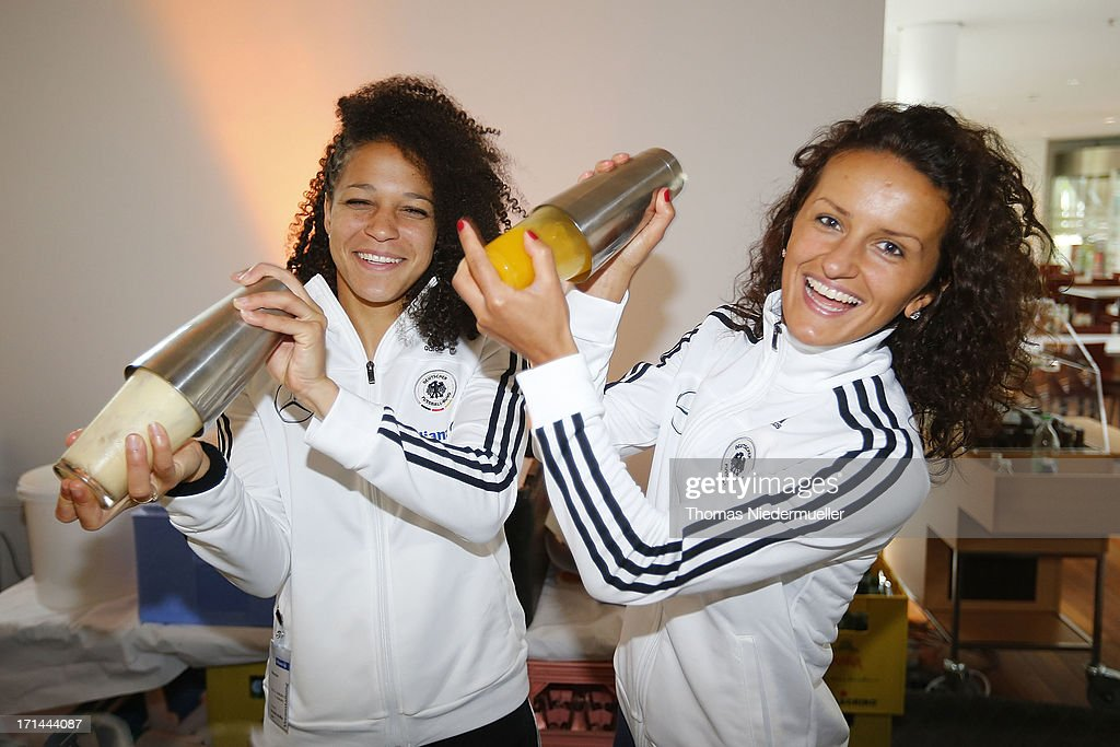 Celia Okoyino da Mbabi (L) and Fatmire Bajramaj (R) are seen during the DFB Team & Sponsors Cooking Event on June 24, 2013 in Munich, Germany.