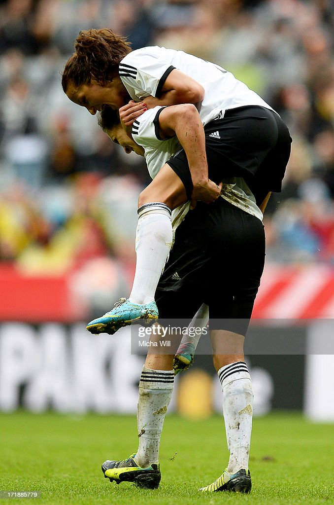 Celia Okoyino da Mbabi (L) celebrates with Fatmire Bajramaj of Germany after scoring her team's third goal during the Women's International Friendly match between Germany and Japan at Allianz Arena on June 29, 2013 in Munich, Germany.