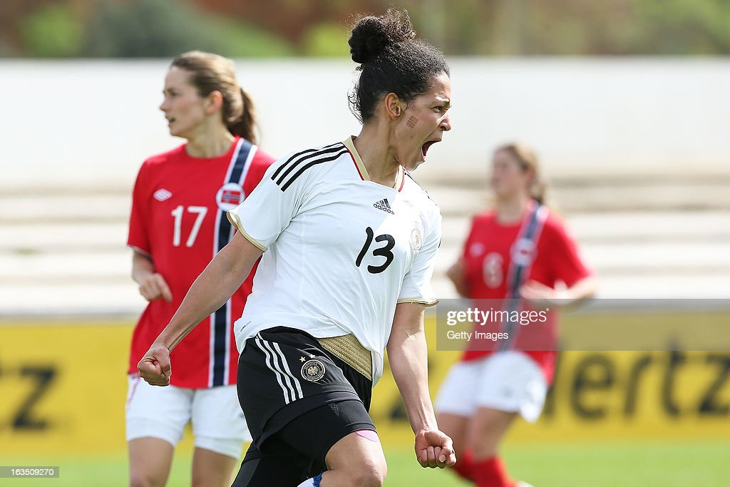 Celia Okoyino Da Mbabi #13 of Germany celebrates a goal during the Algarve Cup 2013 match against Norway at the Estadio Municipal de Lagos on March 11, 2013 in Lagos, Portugal.