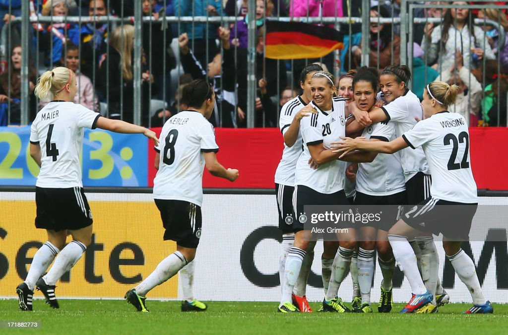 Celia Okoyino da Mbabi (3R) of Germany celebrates her team's second goal with team mates during the Women's International Friendly match between Germany and Japan at Allianz Arena on June 29, 2013 in Munich, Germany.