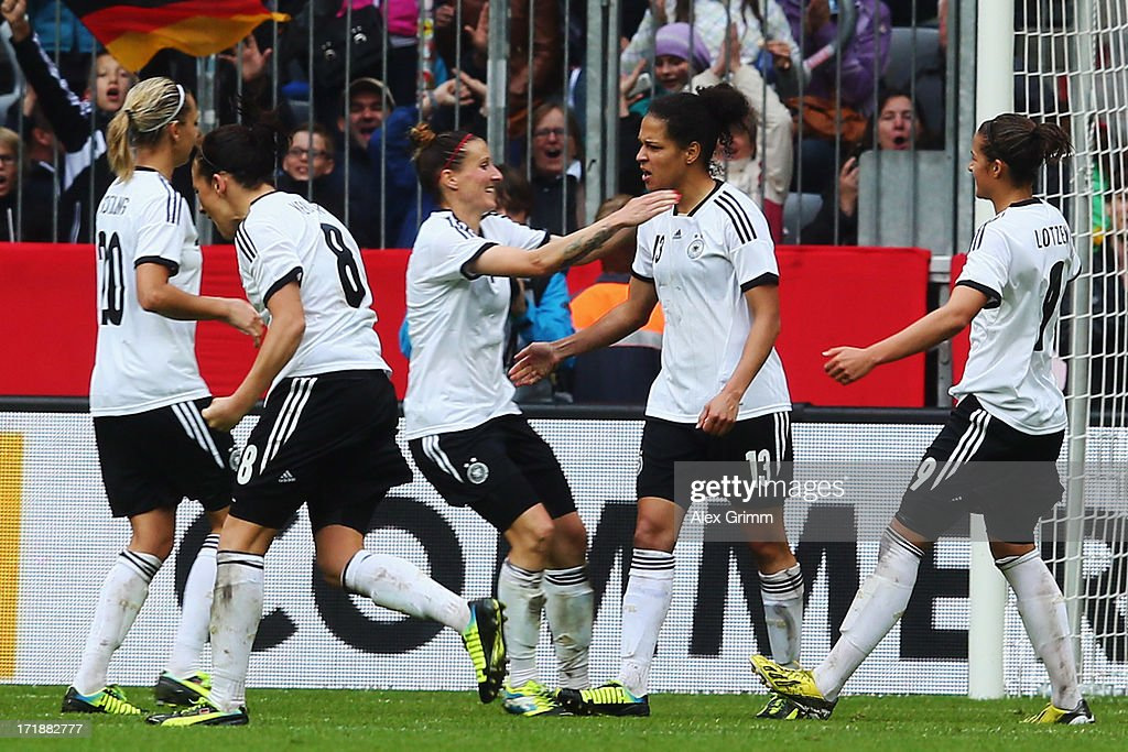 Celia Okoyino da Mbabi (2R) of Germany celebrates her team's second goal with team mates during the Women's International Friendly match between Germany and Japan at Allianz Arena on June 29, 2013 in Munich, Germany.