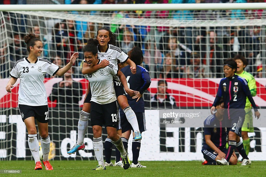 Celia Okoyino da Mbabi of Germany celebrates her team's third goal with team mates Fatmire Bajramaj, Melanie Leupolz and <a gi-track='captionPersonalityLinkClicked' href=/galleries/search?phrase=Simone+Laudehr&family=editorial&specificpeople=639251 ng-click='$event.stopPropagation()'>Simone Laudehr</a> during the Women's International Friendly match between Germany and Japan at Allianz Arena on June 29, 2013 in Munich, Germany.
