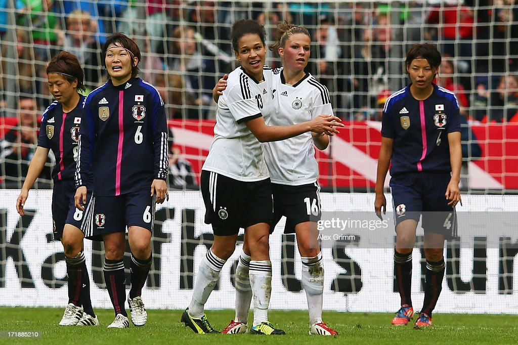 Celia Okoyino da Mbabi of Germany celebrates her team's third goal with team mate Melanie Leupolz during the Women's International Friendly match between Germany and Japan at Allianz Arena on June 29, 2013 in Munich, Germany.