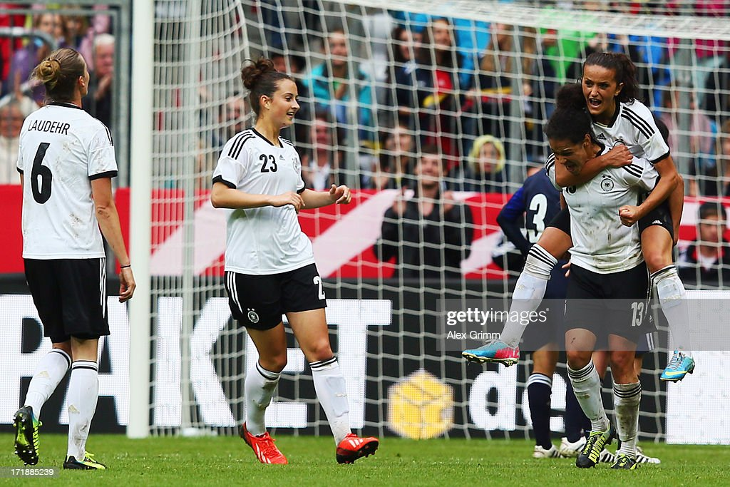 Celia Okoyino da Mbabi of Germany celebrates her team's third goal with team mates Simone Laudehr, Sara Daebritz and Fatmire Bajramaj during the Women's International Friendly match between Germany and Japan at Allianz Arena on June 29, 2013 in Munich, Germany.
