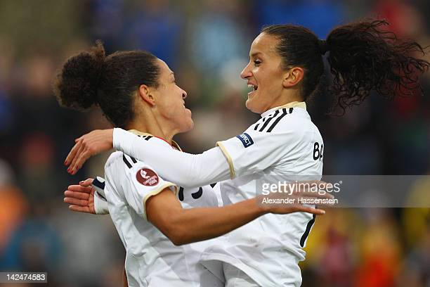Celia Okoyino da Mbabi of Germany celebrates scoring the opening goal with her team mate Fatmire Bajrama during the UEFA Women's EURO Qualifier...