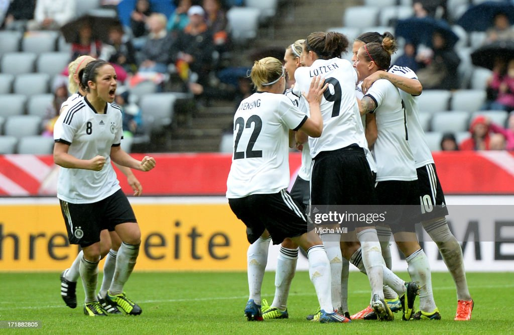 Celia Okoyino da Mbabi #13 of Germany celebrates the third goal with team mates during the Women's International Friendly match between Germany and Japan at Allianz Arena on June 29, 2013 in Munich, Germany.