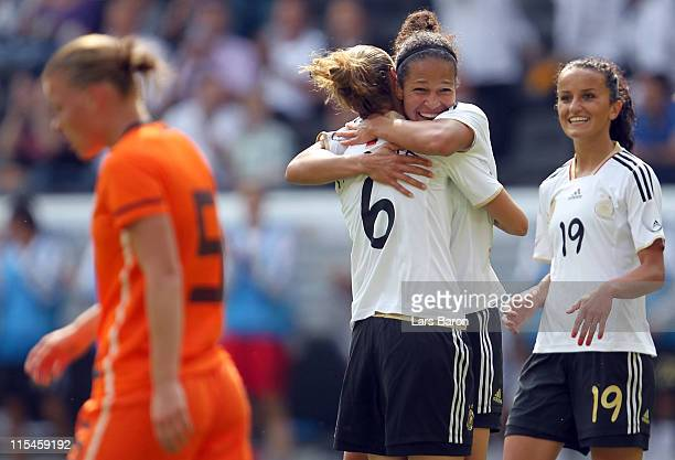 Celia Okoyino da Mbabi of Germany celebrates with Simone Laudehr and Fatmire Bajramaj after scoring her teams first goal during the Women's...