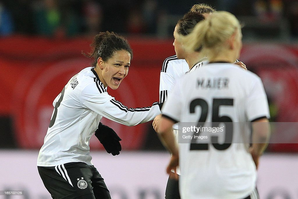 Celia Okoyino da Mbabi of Germany (L) celebrates with team mates after scoring her team's second goal during the Women's International Friendly match between Germany and the United States at Sparda-Bank-Hessen-Stadion on April 5, 2013 in Offenbach, Germany.