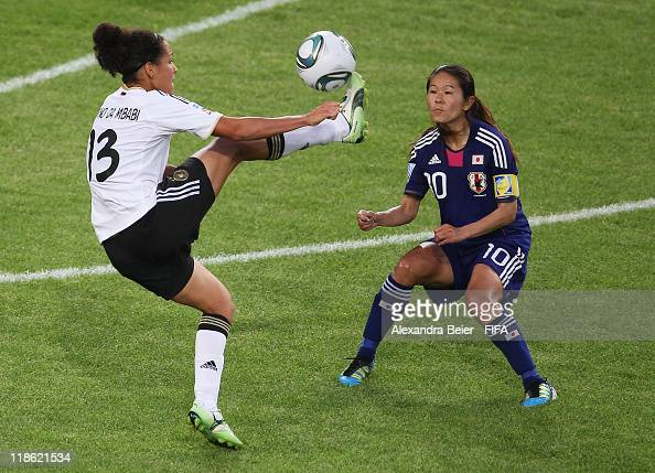 Celia Okoyino Da Mbabi of Germany fights for the ball with Homare Sawa of Japan during the FIFA Women's World Cup quarter finals match between...