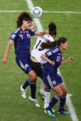 Celia Okoyino Da Mbabi of Germany heads for the ball with Saki Kumagai and Homare Sawa of Japan during the FIFA Women's World Cup quarter finals...