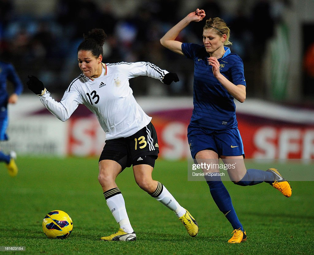 Celia Okoyino da Mbabi of Germany (L) is challenged by Corine Franco of France during the international friendly match between France and Germany at Stade de la Meinau on February 13, 2013 in Strasbourg, France.