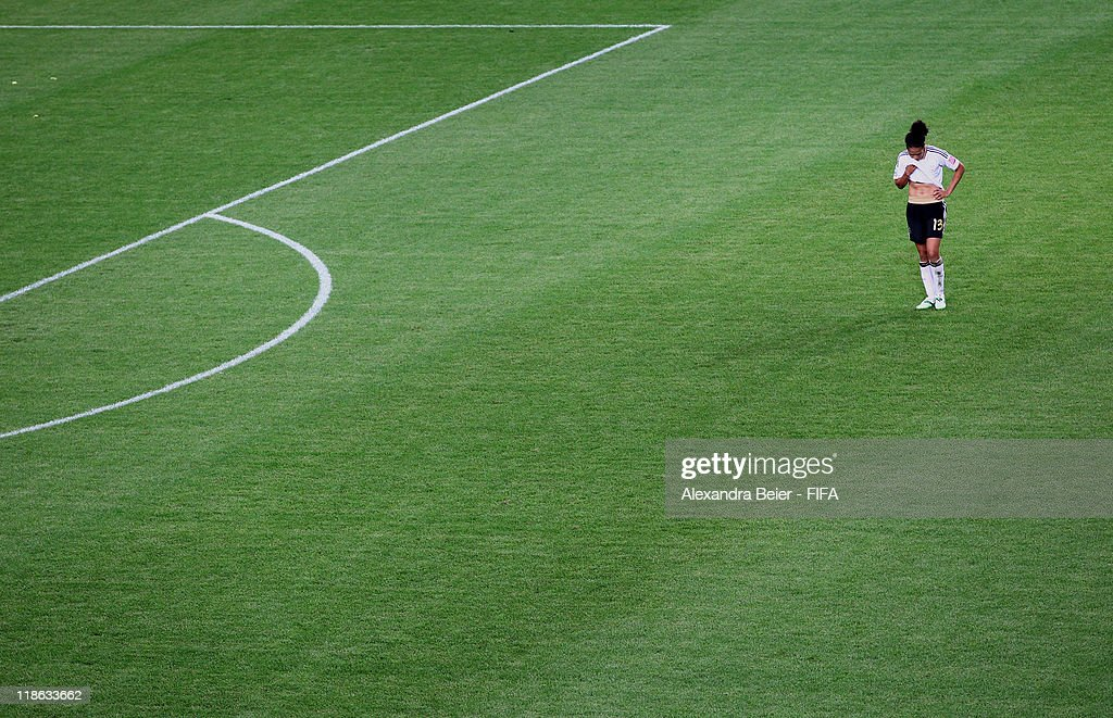 Celia Okoyino Da Mbabi of Germany reacts after her team's loss in the FIFA Women's World Cup quarter finals match between Germany and Japan on July 9, 2011 in Wolfsburg, Germany.