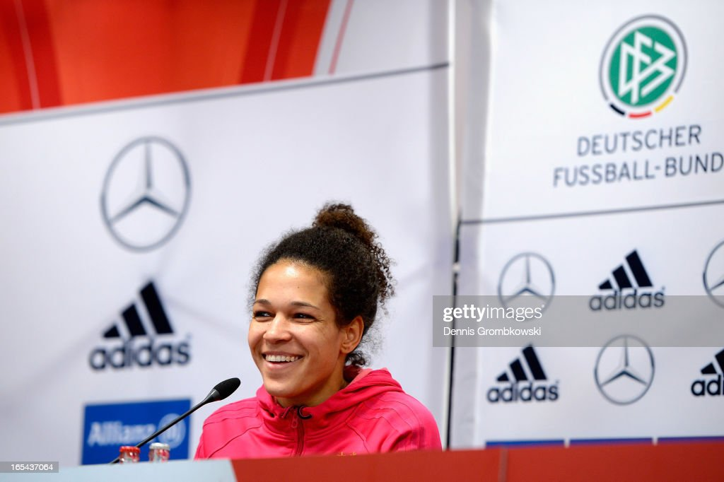Celia Okoyino da Mbabi of Germany reacts during a press conference ahead of their Women's International friendly match against the United States of America on April 4, 2013 in Frankfurt am Main, Germany.