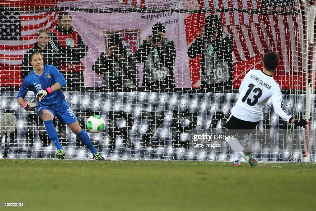 Celia Okoyino da Mbabi of Germany (R) scores her team's second goal against goalkeeper <a gi-track='captionPersonalityLinkClicked' href=/galleries/search?phrase=Nicole+Barnhart&family=editorial&specificpeople=2308552 ng-click='$event.stopPropagation()'>Nicole Barnhart</a> of the United States during the Women's International Friendly match between Germany and the United States at Sparda-Bank-Hessen-Stadion on April 5, 2013 in Offenbach, Germany.