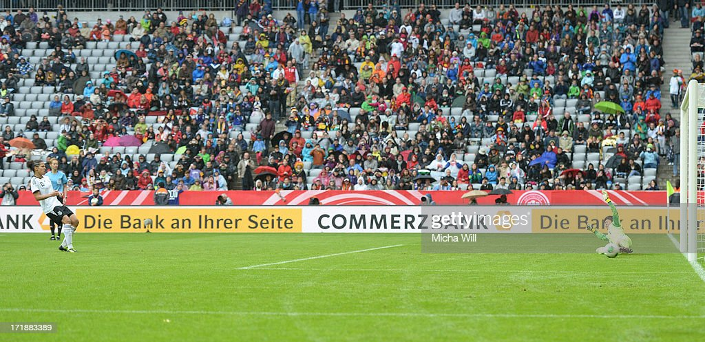 Celia Okoyino da Mbabi #13 of Germany scores the third goal from a penalty during the Women's International Friendly match between Germany and Japan at Allianz Arena on June 29, 2013 in Munich, Germany.