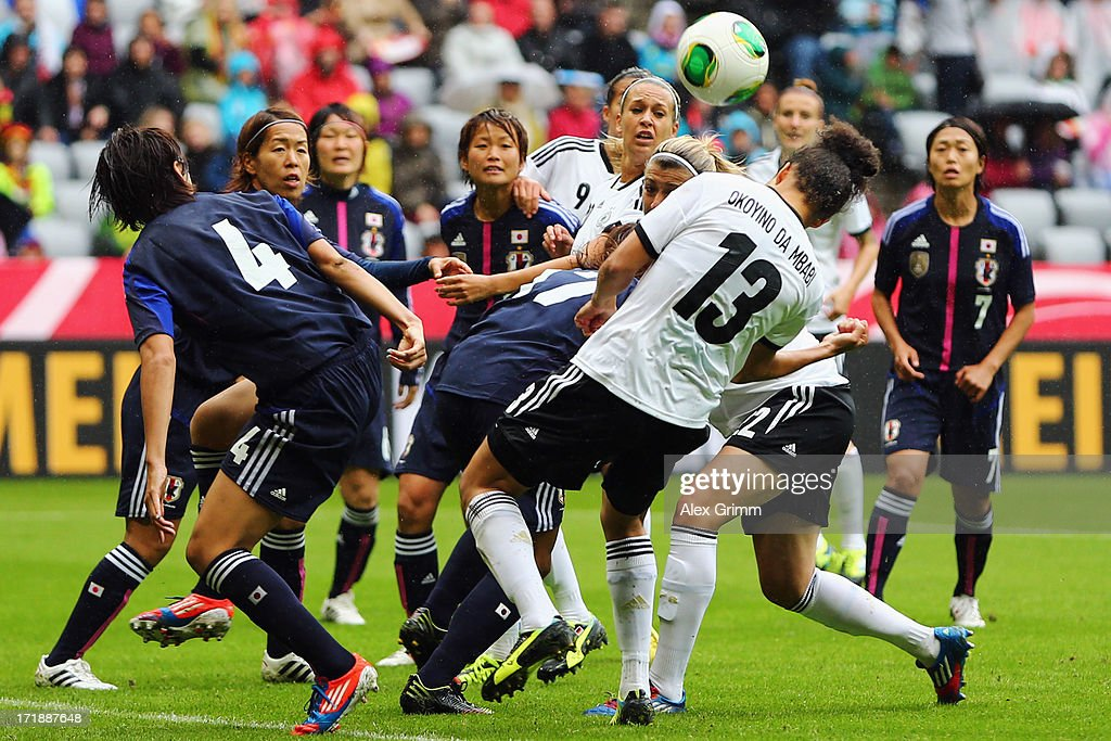 Celia Okoyino da Mbabi (front, R) of Germany tries to score during the Women's International Friendly match between Germany and Japan at Allianz Arena on June 29, 2013 in Munich, Germany.